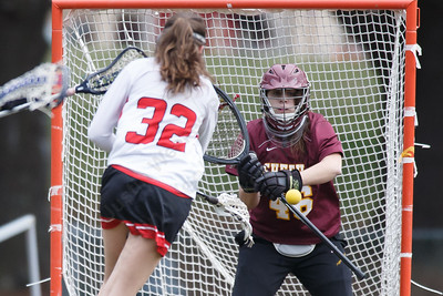 Sheehan's Kaitlin Mills stops a shot from Sacred Heart Academy's Emily Ross Thursday at Sacred Heart Academy in Hamden April 12, 2018   Justin Weekes / Special to the Record-Journal