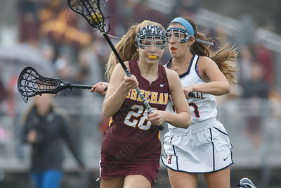 Sheehan's Samantha Hart gets past a defender Friday at Lyman Hall High School in Wallingford April 27, 2018   Justin Weekes / Special to the Record-Journal