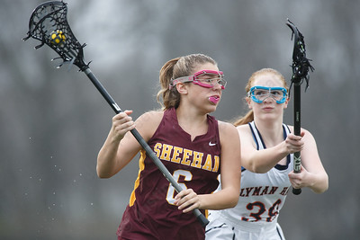 Sheehan's Madison Gaynor works past a defender Friday at Lyman Hall High School in Wallingford April 27, 2018   Justin Weekes / Special to the Record-Journal
