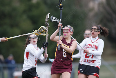 Sheehan's Madison Gaynor gets the Titans on the score board with her first goal Thursday at Sacred Heart Academy in Hamden April 12, 2018 | Justin Weekes / Special to the Record-Journal