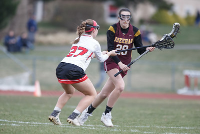 Sheehan's Carlee Crispens works past Sacred Heart's Georgia Rossetti Thursday at Sacred Heart Academy in Hamden April 12, 2018   Justin Weekes / Special to the Record-Journal