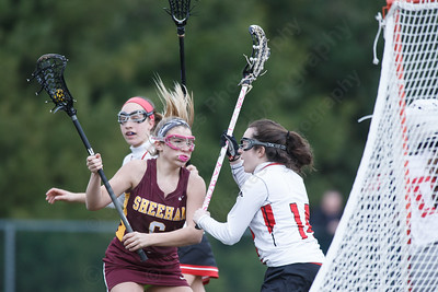 Sheehan's Madison Gaynor drive to the goal Thursday at Sacred Heart Academy in Hamden April 12, 2018   Justin Weekes / Special to the Record-Journal