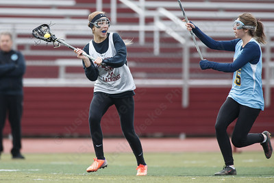 Sheehan's Samantha Hart  looks to pass during a pre-season scrimmage with Westover Wednesday at Sheehan High School in Wallingford March 28, 2018   Justin Weekes / Special to the Record-Journal