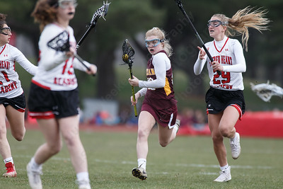 Sheehan's Molly Donegan weave through traffic Thursday at Sacred Heart Academy in Hamden April 12, 2018   Justin Weekes / Special to the Record-Journal