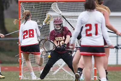 Sheehan's Kaitlin Mills stops a shot from Sacred Heart Academy's Mia Celentano Thursday at Sacred Heart Academy in Hamden April 12, 2018   Justin Weekes / Special to the Record-Journal