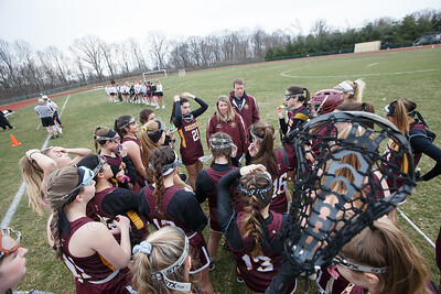 Sheehan's head coach Charissa Zbikowski talks with players Thursday at Sacred Heart Academy in Hamden April 12, 2018   Justin Weekes / Special to the Record-Journal