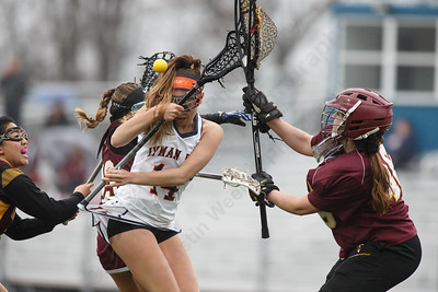 Lyman Hall's Marena DeSimone gets stopped Friday at Lyman Hall High School in Wallingford April 27, 2018   Justin Weekes / Special to the Record-Journal