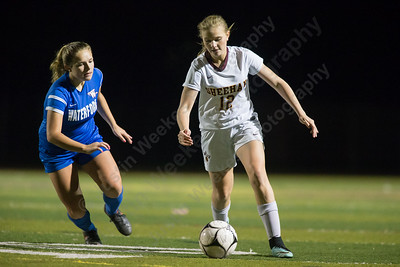 Sheehan's Kelsey Burr gets past a Waterford defender Thursday during second round play in the CIAC Class M tournament at Rittitelli Field on the campus of Sheehan High School in Wallingford. Sheehan defeated Waterford 2 to 0 to move on to the quarter finals. November 9, 2017 | Justin Weekes / For the Record-Journal