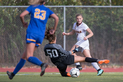 Sheehan's Kelsey Burr sends a crossing pass that gets through Mercy's goalie Allesandra Fronc Saturday at Riccitelli Field in Wallingford October 28, 2017 | Justin Weekes / For the Record-Journal