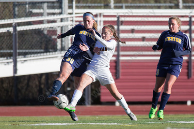 Sheehan's Kara Sullivan is challenged by Weston's Grace Toner Saturday during the CIAC Class M quarterfinals at Riccitelli Field on the campus of Sheehan High School in Wallingford November 11, 2017 | Justin Weekes / For the Record-Journal