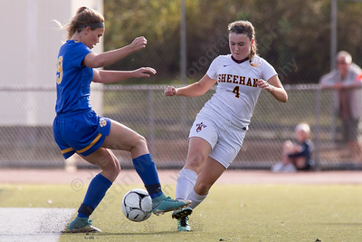 Sheehan's Bethany Gray is challenged by Mercy's Lindsay Stevenson Saturday at Riccitelli Field in Wallingford October 28, 2017 | Justin Weekes / For the Record-Journal