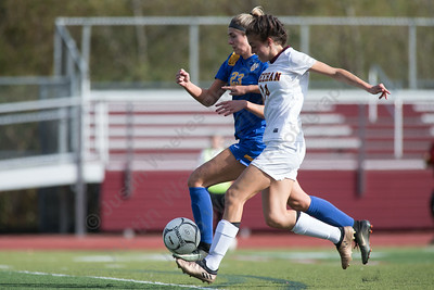 Sheehan's Olivia Dubuc beats Mercy's Madison Webster for a goal tying the game at 1 Saturday at Riccitelli Field in Wallingford October 28, 2017 | Justin Weekes / For the Record-Journal