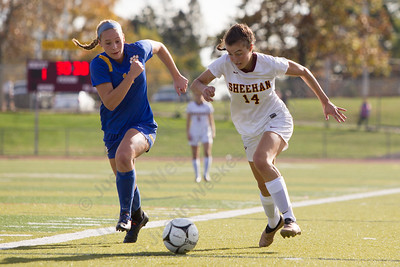 Sheehan's Olivia Dubuc works past Mercy's Sophia Finkeldey Saturday at Riccitelli Field in Wallingford October 28, 2017 | Justin Weekes / For the Record-Journal
