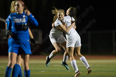 Sheehan's Kelsey Burr and Olivia Dubuc celebrate after Burr's penalty shot puts the Titans up 2 to 1 Thursday during second round play in the CIAC Class M tournament at Rittitelli Field on the campus of Sheehan High School in Wallingford. Sheehan defeated Waterford 2 to 0 to move on to the quarter finals. November 9, 2017 | Justin Weekes / For the Record-Journal