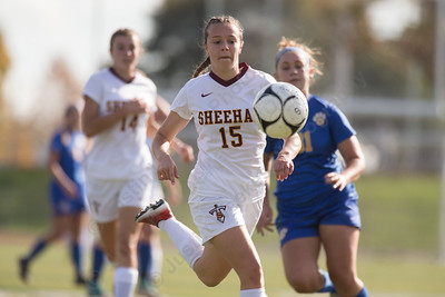 Sheehan's Rayna Esch chases a leading pass Saturday at Riccitelli Field in Wallingford October 28, 2017 | Justin Weekes / For the Record-Journal