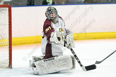 Sheehan's Tyler Robertson glove saves a shot Monday during the CIAC D-III first round play at Remsen Arena on the campus of Choate Rosemary Hall in Wallingford  March 5, 2018 | Justin Weekes / Special to the Record-Journal