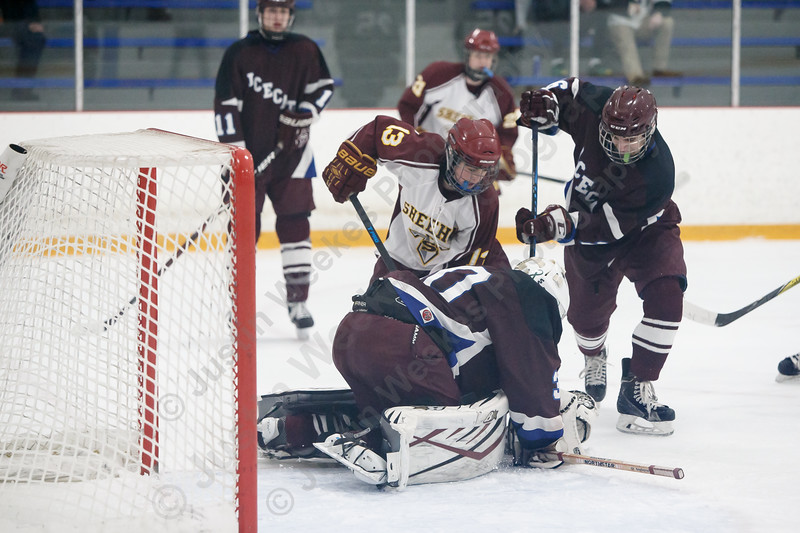 Sheehan's Luke Festa tries to stuff a rebound past BBD's Stephen Fanning Saturday during the SCC DIII Hockey Finals at Bennett Rink in West Haven March 3, 2018 | Justin Weekes / Special to the Record-Journal