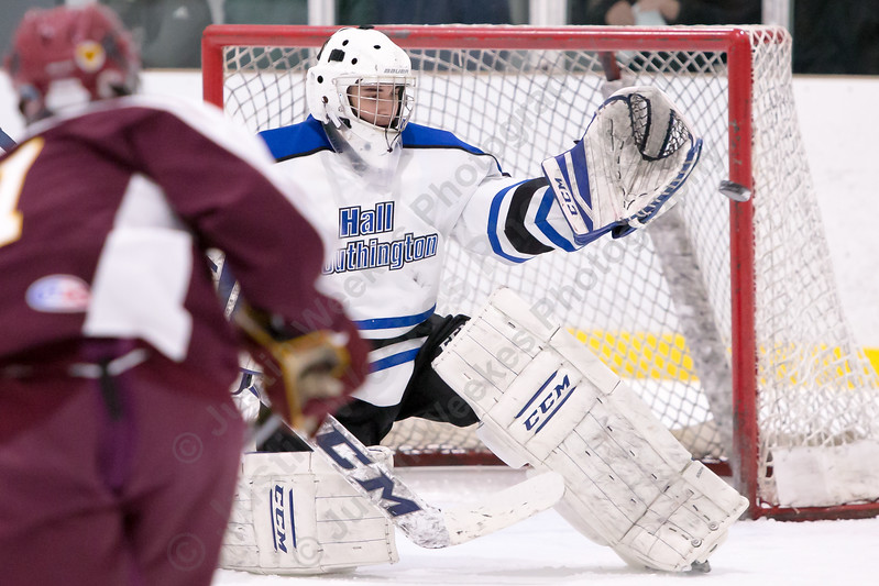 Hall-Southington's Zachary Monti eyes a shot from Sheehan's Dayton Allderige Monday at Veterans Memorial Rink in West Hartford February 26, 2018 | Justin Weekes / Special to the Record-Journal