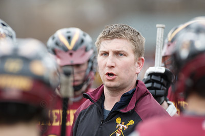 Sheehan's head coach Dan Wostbrock talks with players before a pre-season scrimmage with Haddam-Killingworth Tuesday at Sheehan High School in Wallingford March 27, 2018 | Justin Weekes / Special to the Record-Journal