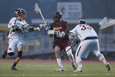 Sheehan's Jacob Smith gets stopped by Lyman Hall's Anthony Perrotti Friday at Lyman Hall High School in Wallingford April 27, 2018 | Justin Weekes / Special to the Record-Journal