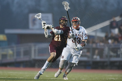 Sheehan's Jacob Smith gets a shot off Friday at Lyman Hall High School in Wallingford April 27, 2018 | Justin Weekes / Special to the Record-Journal