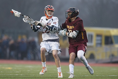 Lyman Hall's Matt Pettit tries to beat Sheehan's Jacob Smith Friday at Lyman Hall High School in Wallingford April 27, 2018 | Justin Weekes / Special to the Record-Journal