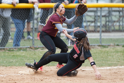Cheshire's Olivia Odermatt (5) slides into third base beating Sheehan's Alexa Dayton (13) tag Tuesday at Pragemann Park in Wallingford Apr. 14, 2015 | Justin Weekes / For the Record-Journal
