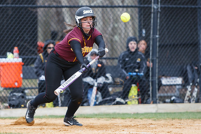 Sheehan's Sara Pisanelli (16) gets a bunt off down the first base line Thursday at Amity Regional High School in Woodbridge Apr. 23, 2015 | Justin Weekes / For the Record-Journal