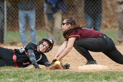 Cheshire's Andrea Russo (1) slides into second knocking the ball from Sheehan's Sara Pisanelli (16) glove Tuesday at Pragemann Park in Wallingford Apr. 14, 2015 | Justin Weekes / For the Record-Journal