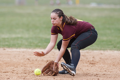 Sheehan's Sara Pisanelli (16) fields a ground ball from Cheshire's Andrea Russo (1) Tuesday at Pragemann Park in Wallingford Apr. 14, 2015 | Justin Weekes / For the Record-Journal