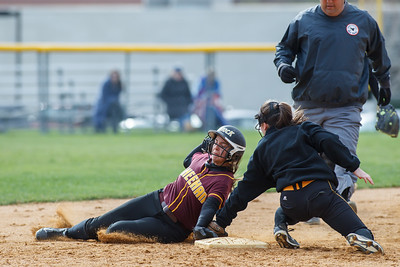 Sheehan's Sara Pisanelli (16) gets caught at second stealing by Amity's Cassidy Kirby (4) Thursday at Amity Regional High School in Woodbridge Apr. 23, 2015 | Justin Weekes / For the Record-Journal
