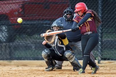 Sheehan's Missy Pereira (19) makes contact with a pitch from Amity's Katie Koshes (2) for a base hit Thursday at Amity Regional High School in Woodbridge Apr. 23, 2015   Justin Weekes / For the Record-Journal