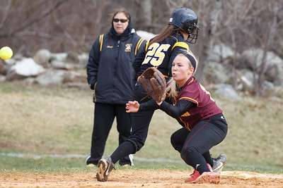 Sheehan's Becca Souza (13) waits for the throw from Mikaeyla Daddio (2) to check the leading Amity's Jenna Thomas (25) at third Thursday at Amity Regional High School in Woodbridge Apr. 23, 2015 | Justin Weekes / For the Record-Journal