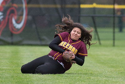 Sheehan's Marissa Gonzalez makes a sliding catch for a fly ball from Cheshire's Sara Mulligan Wednesday at Cheshire High School in Cheshire May. 4, 2016 | Justin Weekes / For the Record-Journal