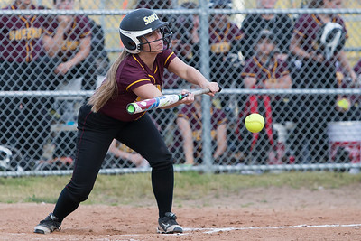 Sheehan's Kelly Brosnan lines up to bunt Monday at Pragemann Park in Wallingford May. 9, 2016 | Justin Weekes / For the Record-Journal