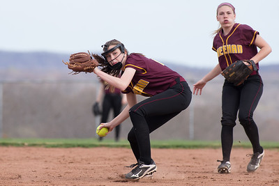 Sheehan's Meghan Murphy fields a hit Monday at Sheehan High School in Wallingford Apr. 17, 2017 | Justin Weekes / For the Record-Journal