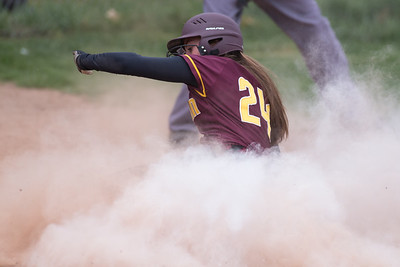 Sheehan's Samantha Iannone slides into home to put the Titans up 1 to 0 Wednesday at Lyman Hall High School in Wallingford Apr. 19, 2017   Justin Weekes / For the Record-Journal