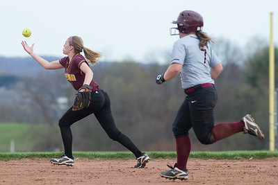 Sheehan's Emily Musso tries to control a hit as North Haven's Caitlin Ranciato runs to third Monday at Sheehan High School in Wallingford Apr. 17, 2017 | Justin Weekes / For the Record-Journal