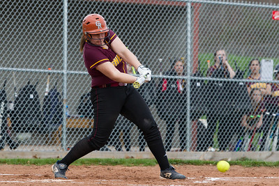 Sheehan's Carolyn Biel makes contact for a ground ball Monday at Sheehan High School in Wallingford Apr. 17, 2017 | Justin Weekes / For the Record-Journal