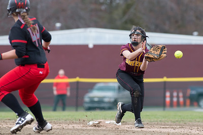 Sheehan's Christiana Amarone misses the throw as Cheshire's Alexis Hemstock  advances Wednesday at Cheshire High School in Cheshire Apr. 5, 2017 | Justin Weekes / For the Record-Journal
