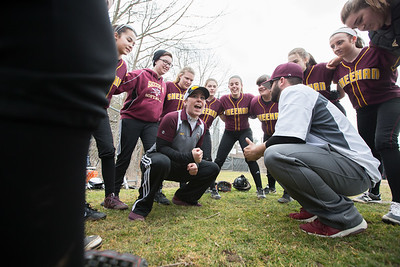Sheehan's head coach Sarah Wyant and the Titans get ready to face Cheshire Wednesday at Cheshire High School in Cheshire Apr. 5, 2017 | Justin Weekes / For the Record-Journal