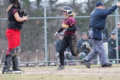 Sheehan's Gabrielle Fiedler crosses home putting the Titans on the board first Wednesday at Cheshire High School in Cheshire Apr. 5, 2017 | Justin Weekes / For the Record-Journal