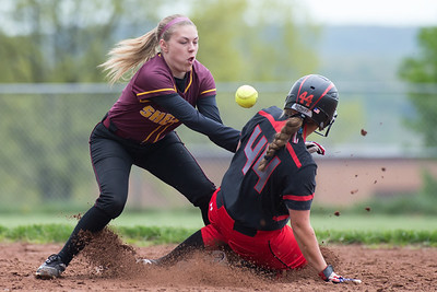 Cheshire's Alexis Hemstock slides into second as Sheehan's Emily Musso bobbles the throw Tuesday at Sheehan High School in Wallingford May. 9, 2017   Justin Weekes / For the Record-Journal