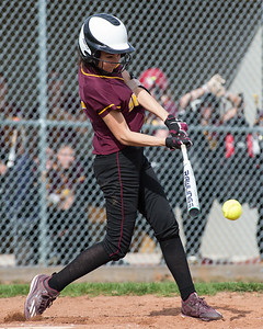 Sheehan's Tea Martin gets on board with a base hit Monday at Sheehan High School in Wallingford Apr. 17, 2017 | Justin Weekes / For the Record-Journal