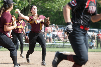 Sheehan's Samantha Iannone throws out Cheshire's Brianna Pearson at first Wednesday during the quarterfinal round if the SCC tournament at Cheshire High School in Cheshire  May 23, 2018   Justin Weekes / Special to the Record-Journal