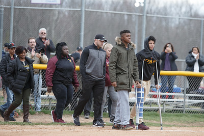 Sheehan's Ernest (Tre) Childers left and Jordan Davis lead their family members out for the first pitch Wednesday at Pragemann Park in Wallingford April 18, 2018 | Justin Weekes / Special to the Record-Journal