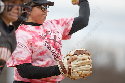 Sheehan's Marissa Gonzalez throws out Lyman Hall's Kate Miller at first Wednesday at Pragemann Park in Wallingford April 18, 2018 | Justin Weekes / Special to the Record-Journal