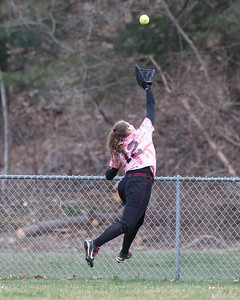 Sheehan's Caitlyn Hunt jumps to try and grab a shot from Lyman Hall's Elise Hastings Wednesday at Pragemann Park in Wallingford April 18, 2018 | Justin Weekes / Special to the Record-Journal