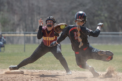 Sheehan's Nicole Dorsey tags out Cheshire's Mia Juodiatis Sunday at Pragemann Park in Wallingford April 8, 2018 | Justin Weekes / Special to the Record-Journal