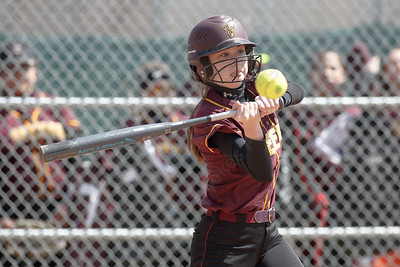 Sheehan's Meghan Murphy drives a hit deep to left center Sunday at Pragemann Park in Wallingford April 8, 2018 | Justin Weekes / Special to the Record-Journal